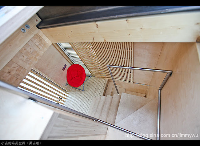 Photo of the wooden staircase inside of the sustainable micro house