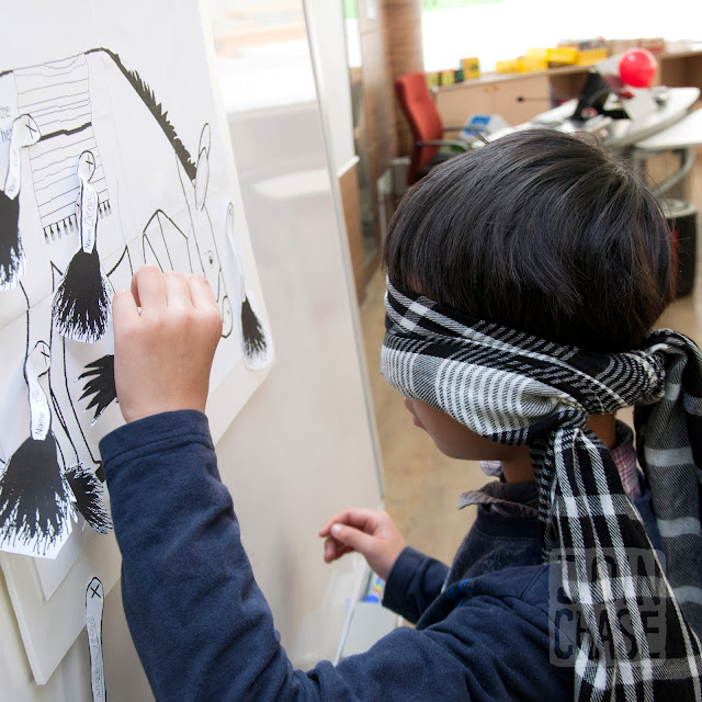 "A student playing ""Pin the Tail on the Donkey"" during Winter English Camp at Bibong Elementary in Ochang, South Korea."