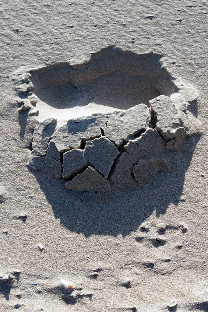 footstep in sand with shadow