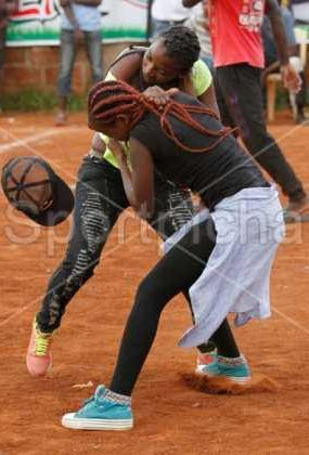 Photos: Two women fights over a man during a football match in Kenya