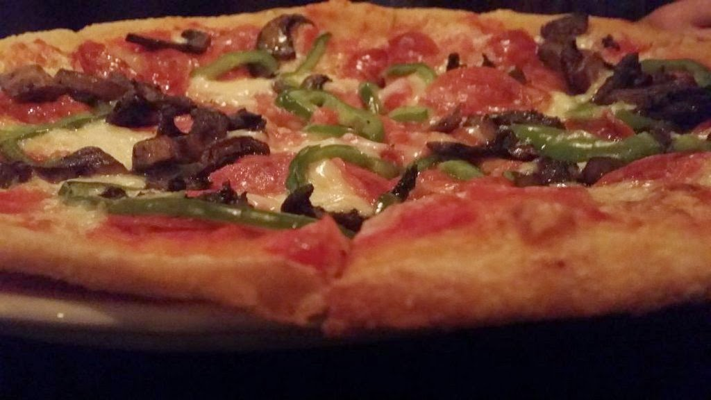 Pepperoni Pizza with pepperoni, green peppers, mushrooms, tomato sauce, mozzarella Mr. Ciao Toronto