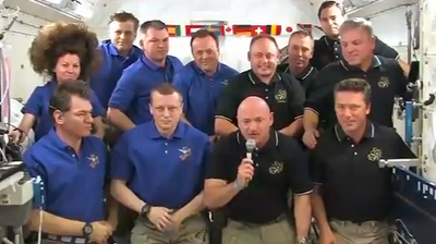 The crew of 12 at the ISS salute the Pope via direct link with the Vatican. NASA 2011.