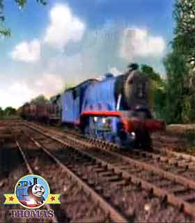 Thomas and friends Gordon the train chased along the rails with big heavy cargo Sodor railway trucks
