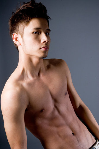 Teen Asian fashoin male model in blue jeans
