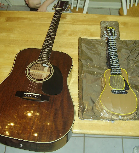 Real Guitar next to Guitar Cake