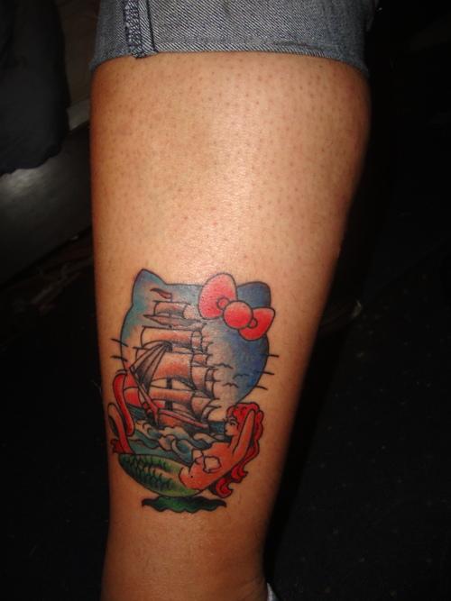 Heritage tattoo hello kitty tattoo for Hello kitty tattoo sleeve