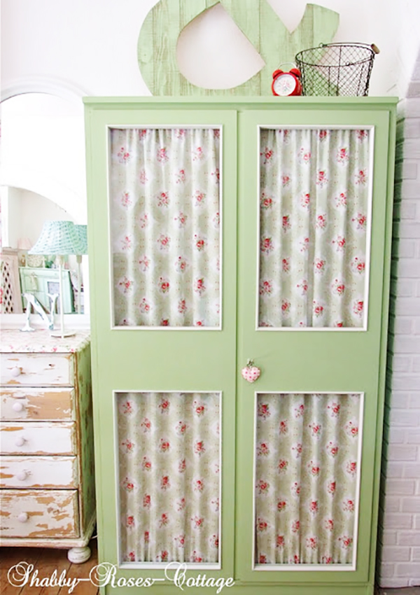 green painted wardrobe for with fabric in the background- f you loved painted furniture or are thinking about using Chalk paint on furniture for the first time then you should check this post full of 25 incredible makeoevers. 25 Fabulous painted furniture ideas!