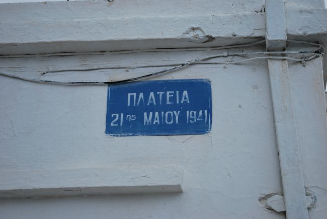 Blue sign on white wall in greek Plateia 21st May 1940