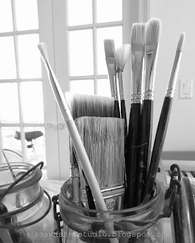 Paint brushes in vintage jars