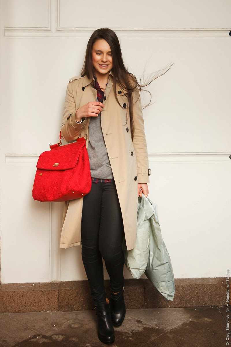 smiling brunette with red bag
