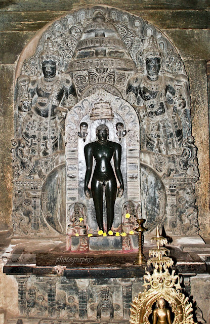 Statue of Mahavira, with golden statue in the front