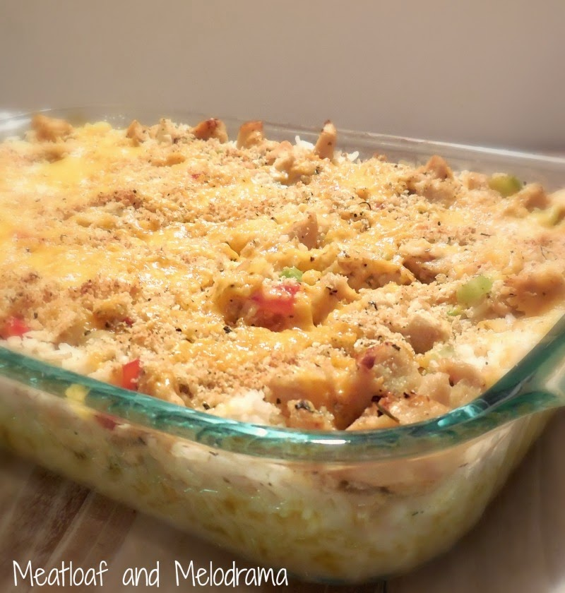 chicken and rice casserole topped with bread crumbs and cheese