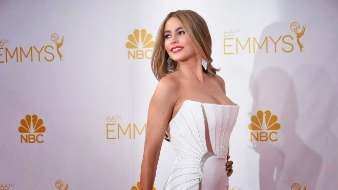 Of course, there's no exception if Sofia Vergara is one of a perfect lady ever although her ages hanging on the middle. Looked lovely in a white gown, the 42-year-old cuddled up on the red carpet at Emmy Award in Los Angeles on Monday, August 25, 2014.