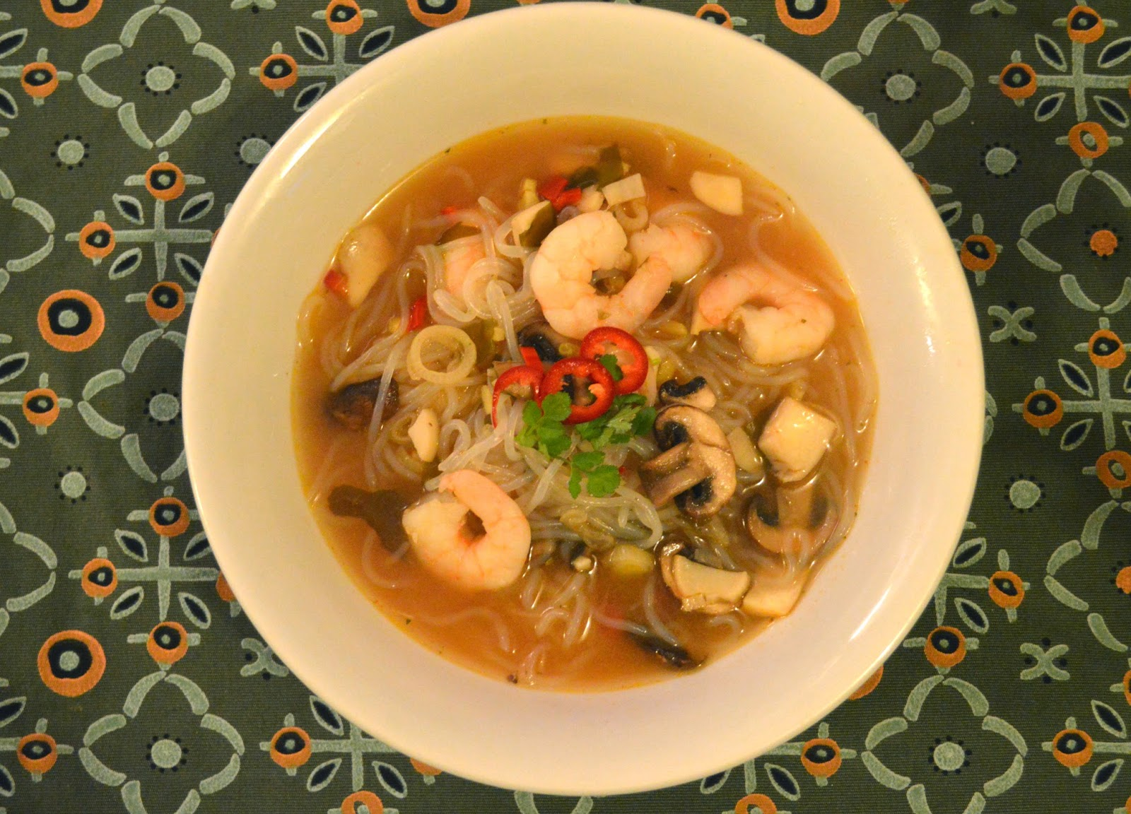 spicy yellow miso soup with king prawns and mushrooms