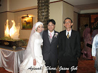 Newlyweds Azimah and Shera flanked by Jason Geh