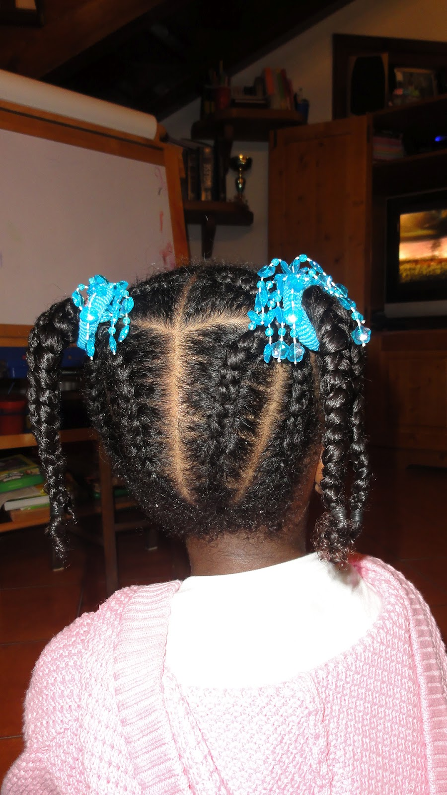 The Rest Of Each Side Parted Into 5 Sections And Cornrowed Toward Center Where Hair Is Banded Braided Two Hanging Ponytails On