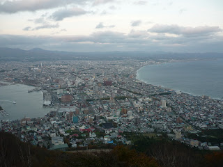 Hakodate city during the day taken from Mount Hakodate with ocean on both sides