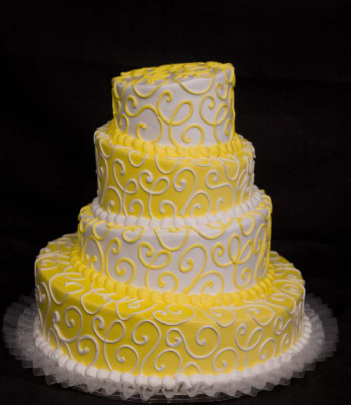 Ontario Bakery: wedding cakes Chino Hills: Yellow and white topsy-turvy