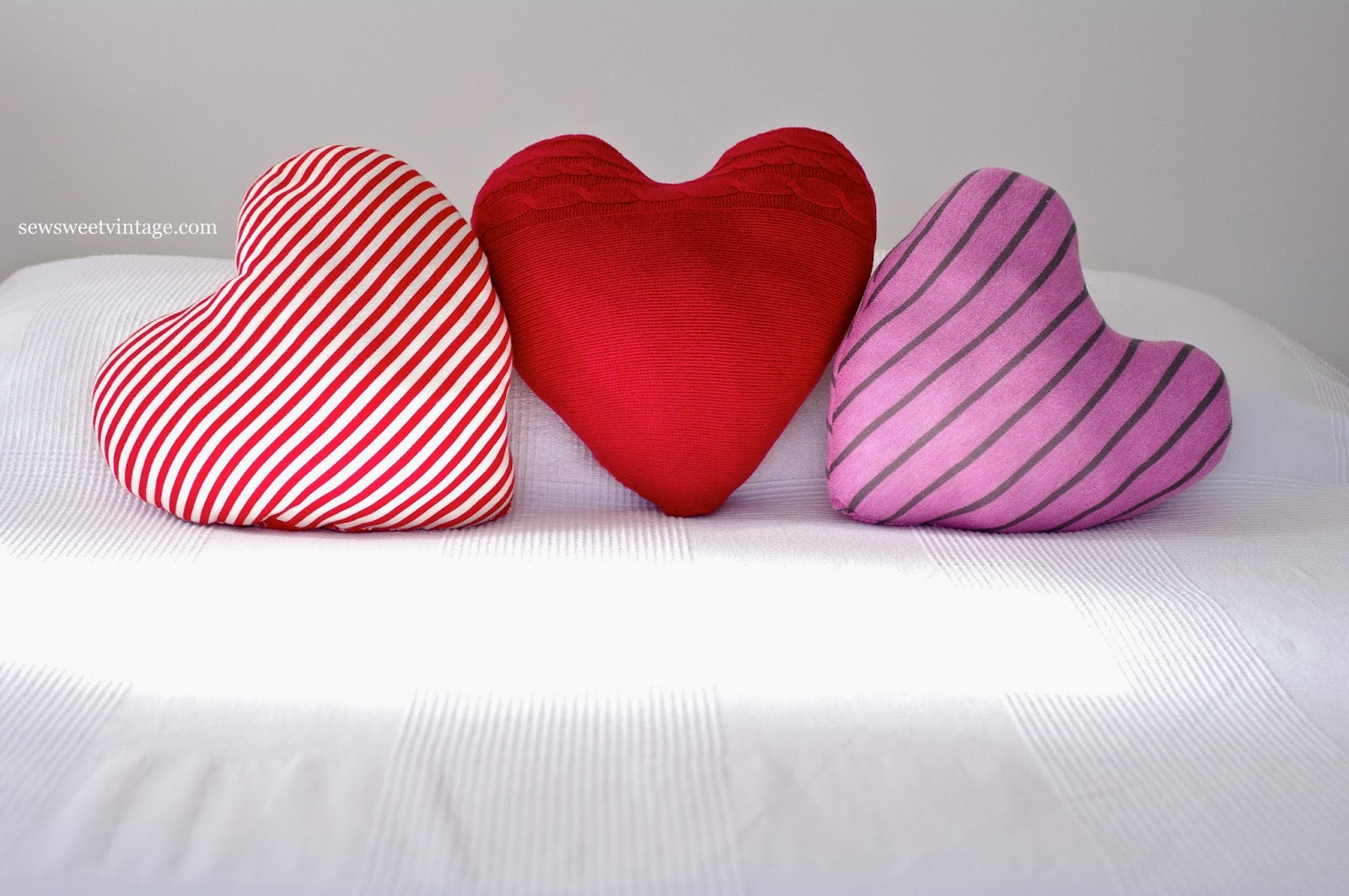 DIY heart pillow made using recycled sweater and shirt fabrics