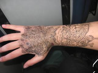 http://designertattooyakuza.blogspot.com/-designer-writing-tattoos-yakuza.html