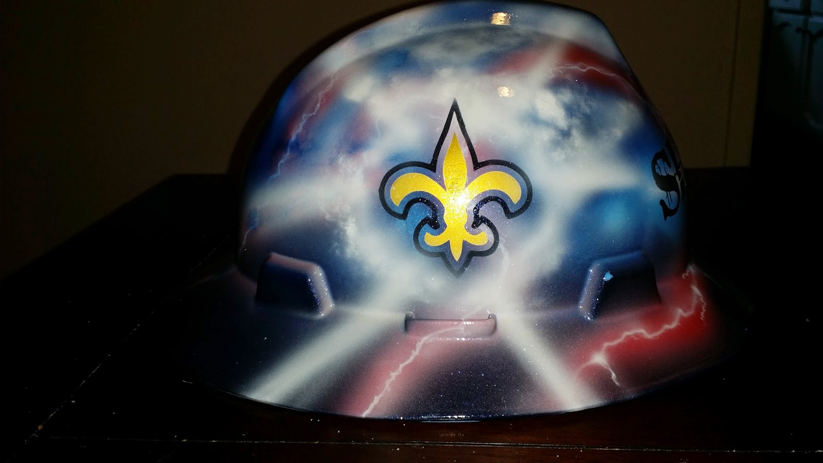 custom designed hard hat with New Orleans Saints coming through the storm