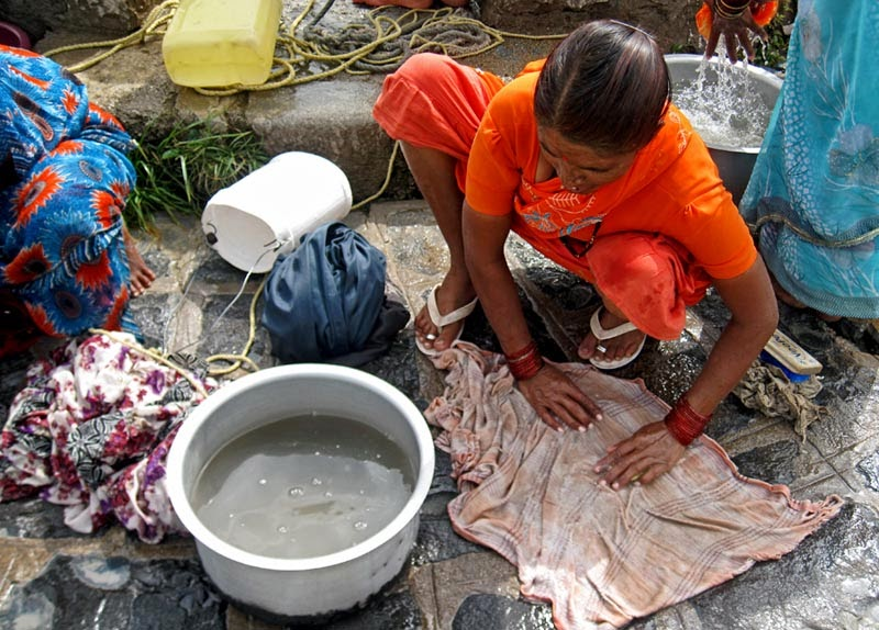 woman washing clothes by hand