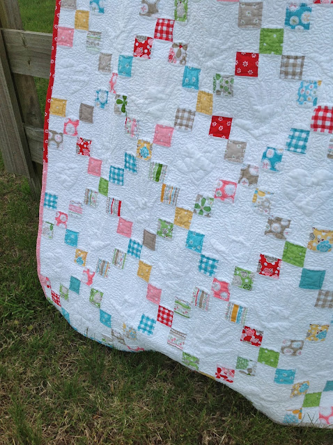 White Quilt with Embroidery and Colorful Patterned Blocks