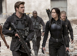 Liam Hemsworth and Jennifer Lawrence in The Hunger Games: Mockingjay Part 1, on EPIX