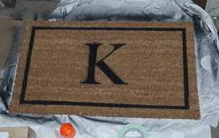 Doormat with border and letter K