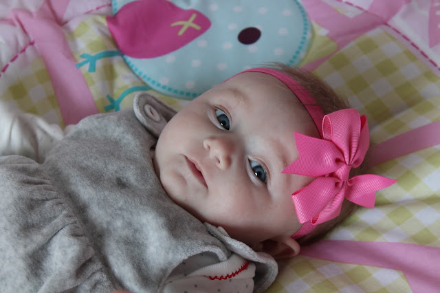 baby girl wearing hot pink bow headband