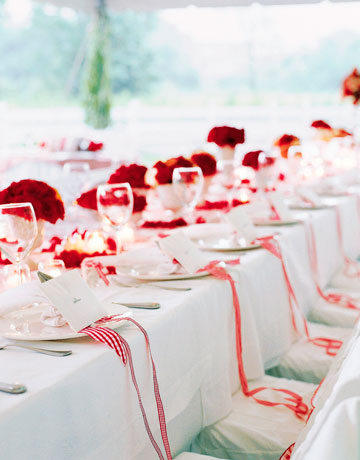 The white bowls of red flowers possibly carnations if so they're great