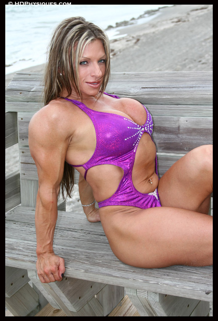 Debi Laszewski Flexes Her Chest And Triceps