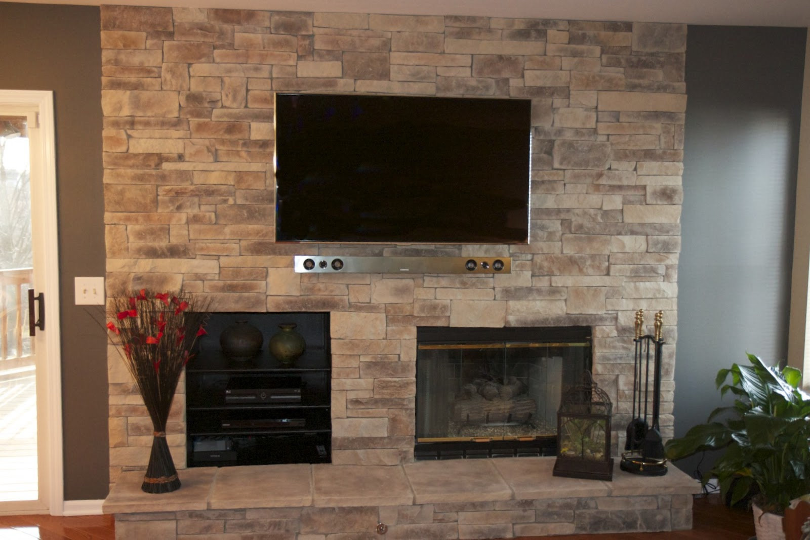 Stone Wall Living Room with Fireplace