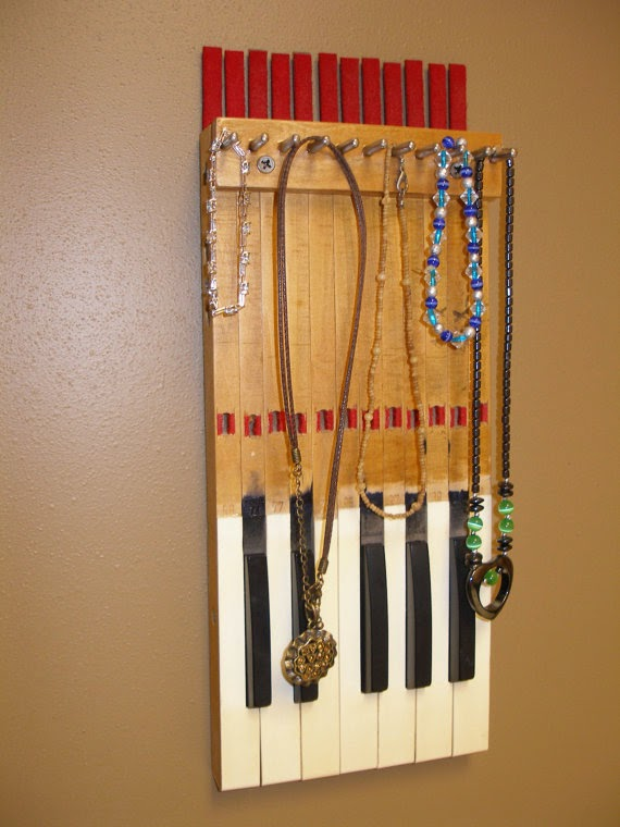 10 ways to upcycle old musical instruments thee kiss of for Repurposed drum shelf