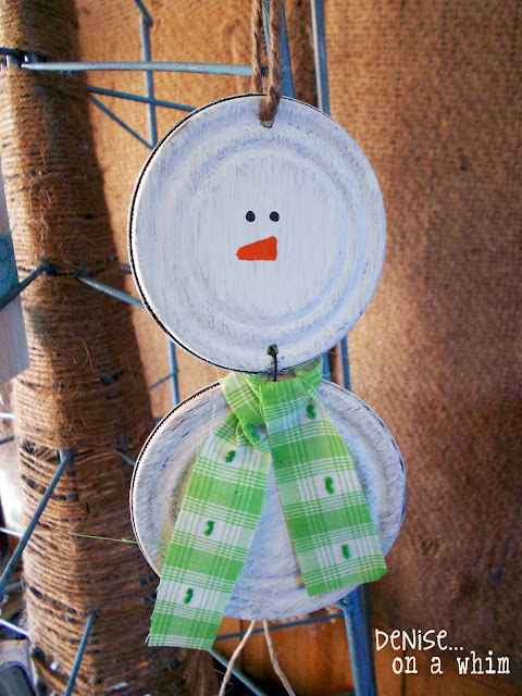 Adding a touch of white paint to a couple of jar lids to create a snowman ornament