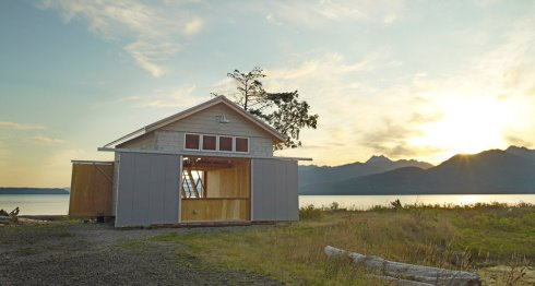 Boathouse with Unique Exterior Sliding Doors Content in a Cottage