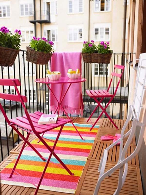 Metal chairs or sets of chair with a petite table are very compact, weatherproof, and if you can't find them in bright colors, you can easily spray paint