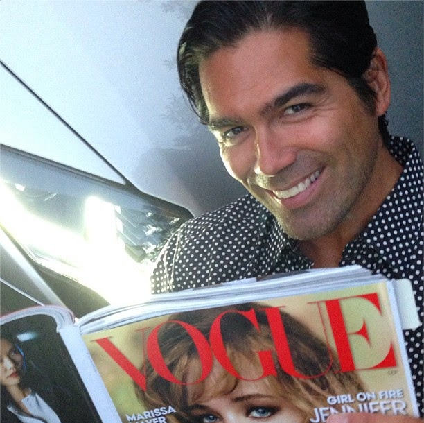 Shoe designer, Brian Atwood, reading his September Issue.