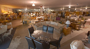 We have 30,000 square feet of warehouse space!  That's a LOT of used furniture!