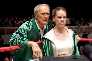 Maggie Fitzgerald junto a su entrenador.