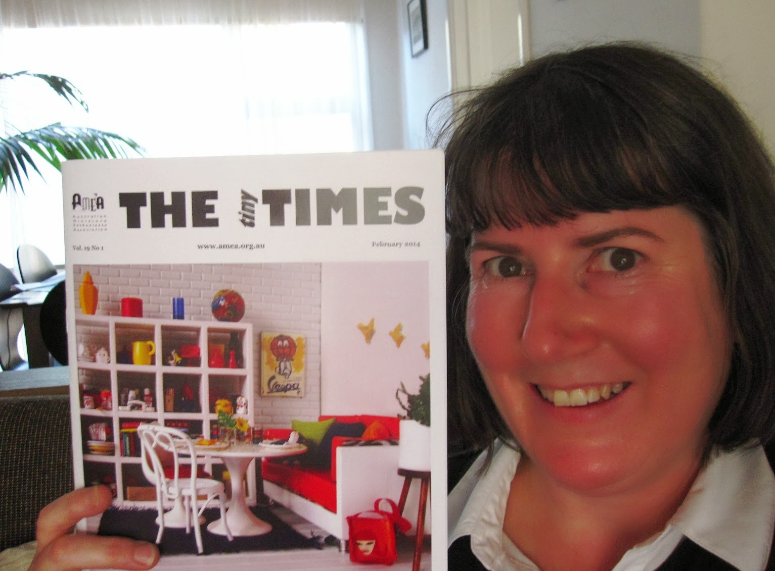 Assistant Editor Anna-Maria C Sviatko holding up the February 2014 issue of The tiny Times
