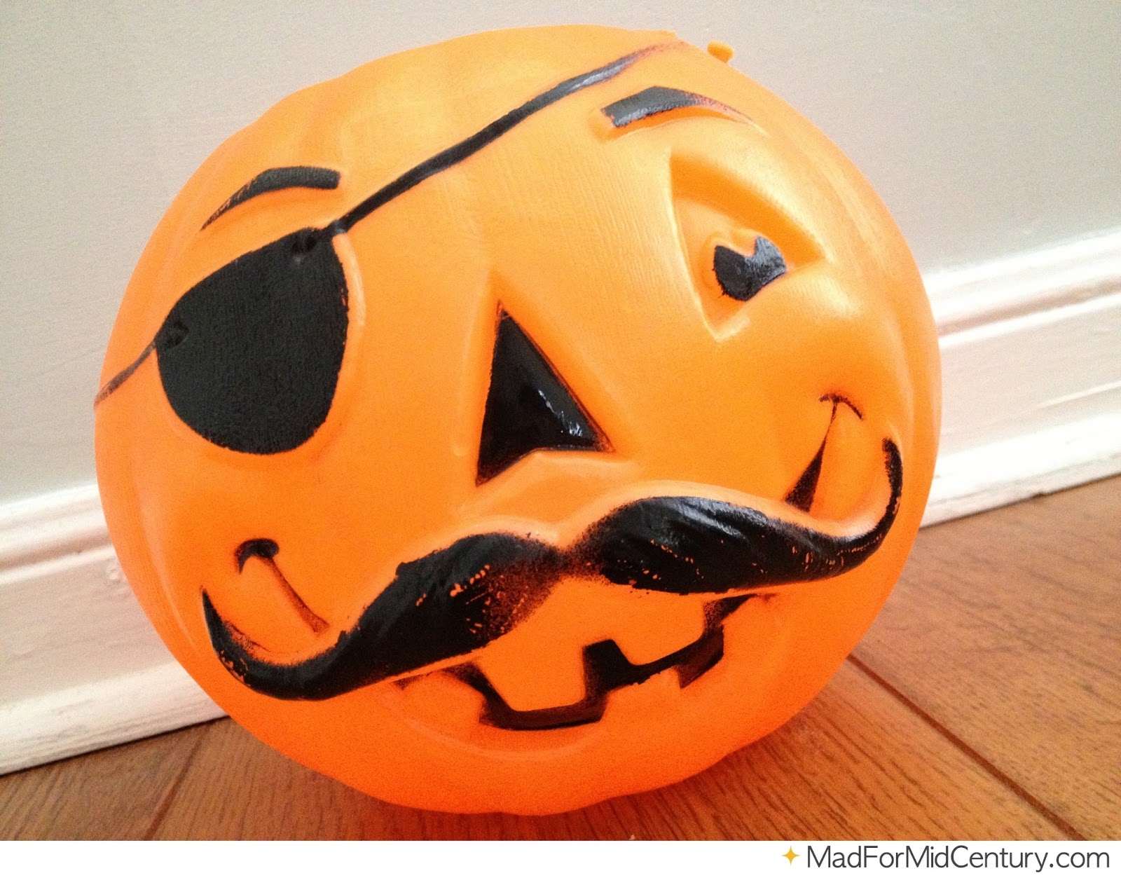 Vintage halloween decorations plastic - It S Your Standard Plastic Pumpkin Candy Bucket Except 100 Times Better Because It Has Both An Eye Patch And A Handlebar Mustache It S Missing The Handle