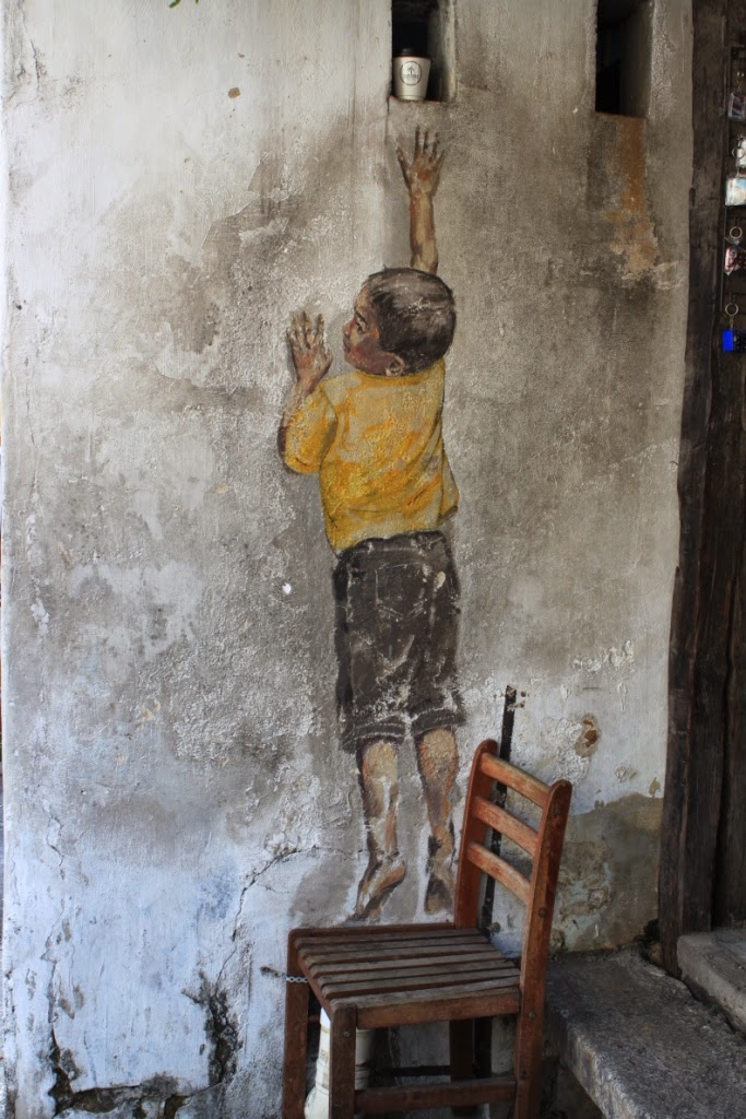 Penang street art - Boy on chair - Ernest Zacharevic