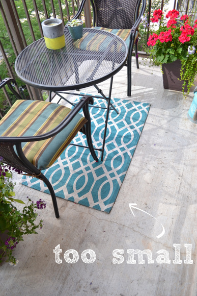 This outdoor rug is way too small for this space, even though I love the teal blue color and fun pattern.