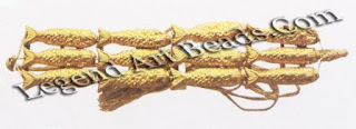 The legacy of ancient craftsmanship is exemplified in this finely-worked sheet gold bracelet in the form of fishes.