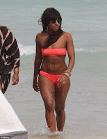 Bikini candids Alexandra Burke wear a tiny orange two-piece in picture gallery