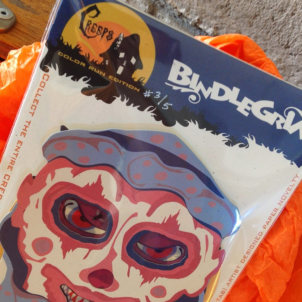 Close-up creepy clown in packaged set of printed and diecut designs by Halloween artist Bindlegrim