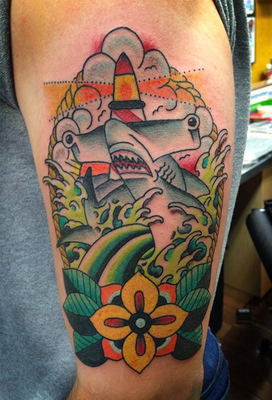 Tattoo of a hammerhead shark with lighthouse by Tattoo artist Mark Stewart for Triumph Tattoo