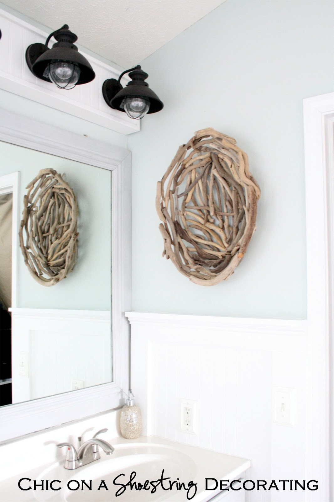 Chic on a shoestring decorating beachy bathroom reveal for Wall art for master bathroom