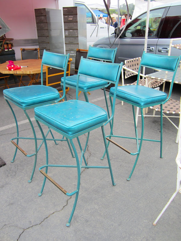 4 teal metal bar stools with vinyl seat and back covers